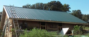 This picture shows the new metal roof that was installed. We ended up completely rebuilding the roof with new rafters since the old ones were undersized and in bad shape.